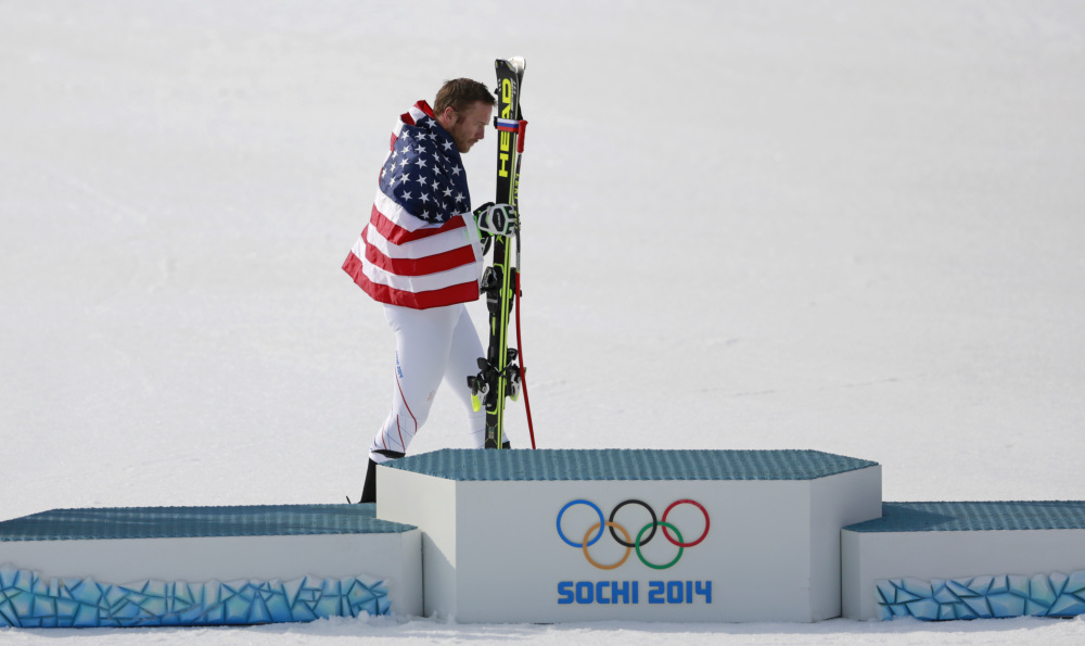 United States' Bode Miller walks to the podium after winning the joint bronze medal in the men's super-G.