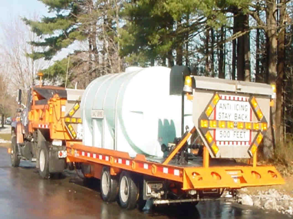 SALT: A state Department of Transportation truck pulls a container of salt brine.