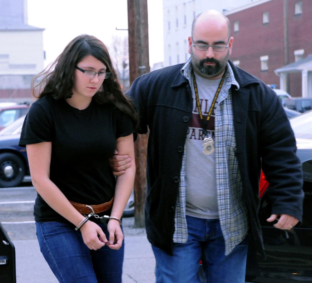 Miranda K. Barbour is led into District Judge Ben Apfelbaum's office in Sunbury, Pa., by Sunbury policeman Travis Bremigen in December.