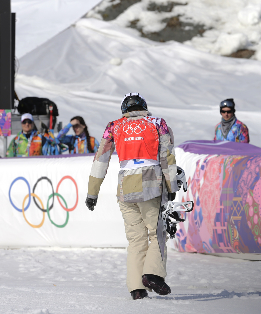 Lindsey Jacobellis of the United States walks off after crashing in the second semifinal of the women's snowboard cross.