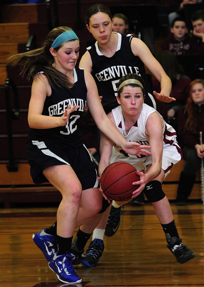 Staff photo by Joe Phelan RIchmond's Merenda Martin, bottom right, is double teamed by Greenville's Shelby Ward, left, and Rebecca Huettner during a game on Thursday January 23, 2014 at RIchmond High School.
