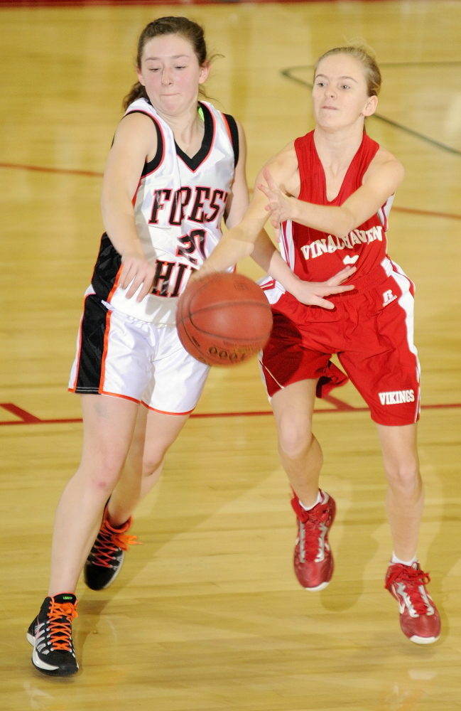 KNOCK IT OFF: Forest Hills junior guard Keely Taylor, left, knocks ball away from Vinalhaven sophomore guard Hannah Noyes during a Western Class D tournament game Tuesday 4 at the Augusta Civic Center. The Tigers won 70-27.