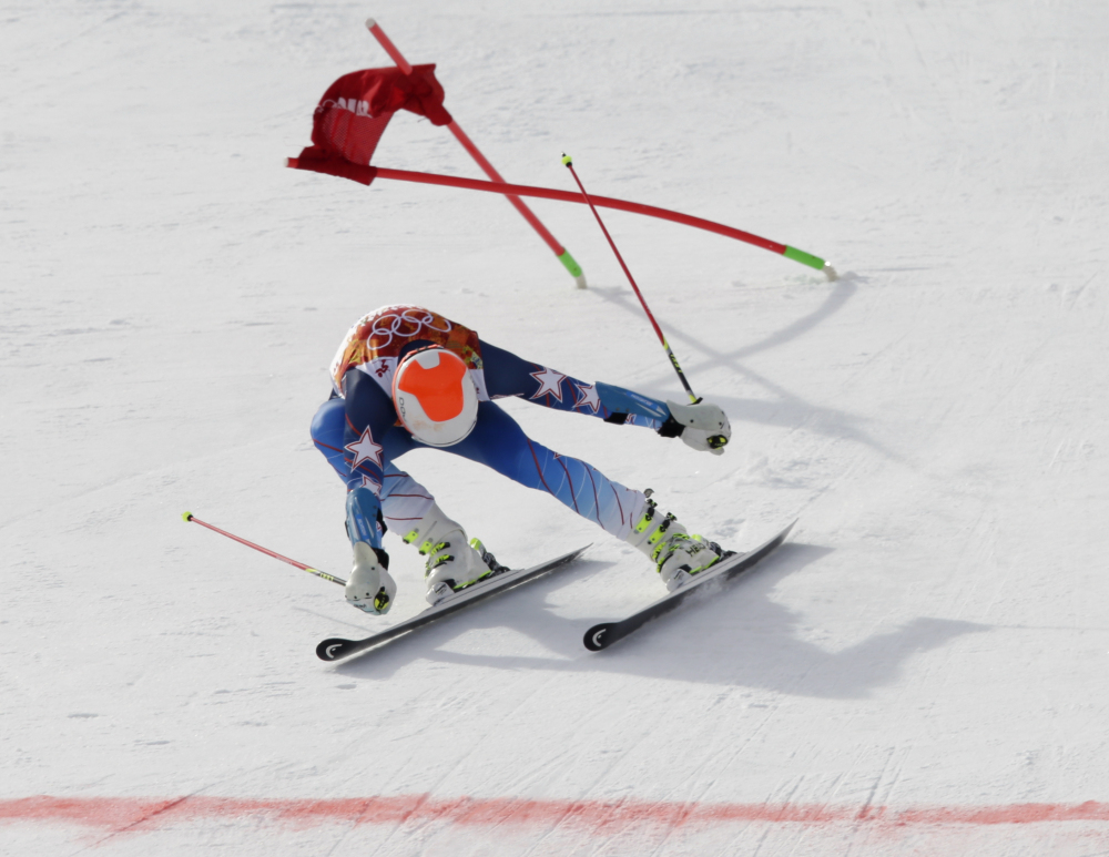 Bode Miller skis past a gate near the finish line during the first run of the men's giant slalom the Sochi 2014 Winter Olympics on Wednesday.