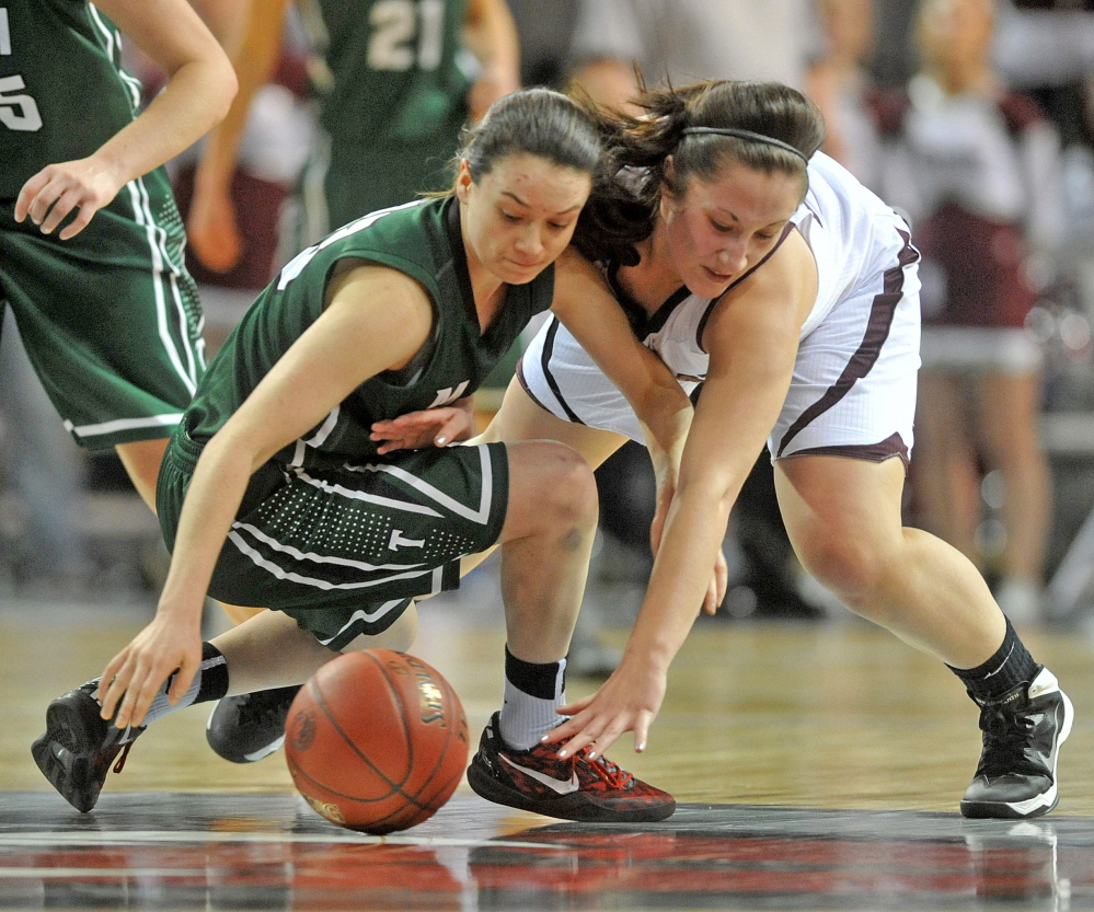 SCRAMBLE: Nokomis' Mikalya Charters, right, and Mount Desert Island's Sierra Tapley battle for the loose ball in the second half Wednesday at the Cross Center in Bangor. MDI defeated Nokomis 46-44.