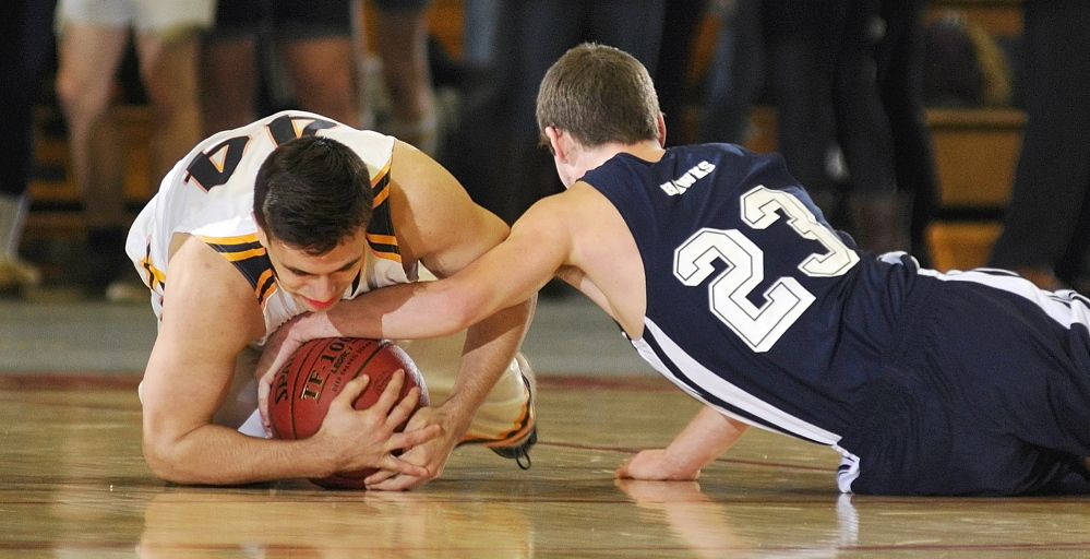 Hyde's Talin Rowe, left, and North Haven's Zebadiah Campbell wrestle for a loose ball during their Western Class D boys' basketball semifinal Wednesday at the Augusta Civic Center. Hyde advanced with a 49-39 victory.