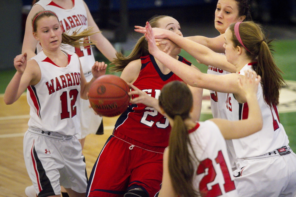Wells defenders put heavy pressure on Gray-New Gloucester's Alanna Camerl during their Western Class B girls' basketball quarterfinal Wednesday at the Portland Expo. Wells won, 49-30.
