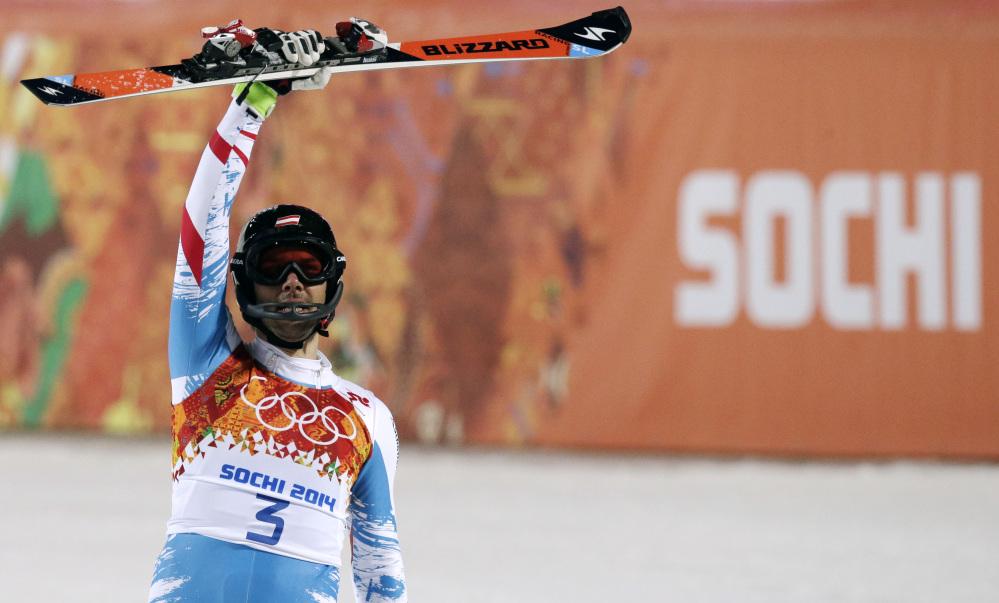 Austria's Mario Matt celebrates winning the gold medal in the men's slalom Saturday at the Sochi 2014 Winter Olympics in Krasnaya Polyana, Russia.
