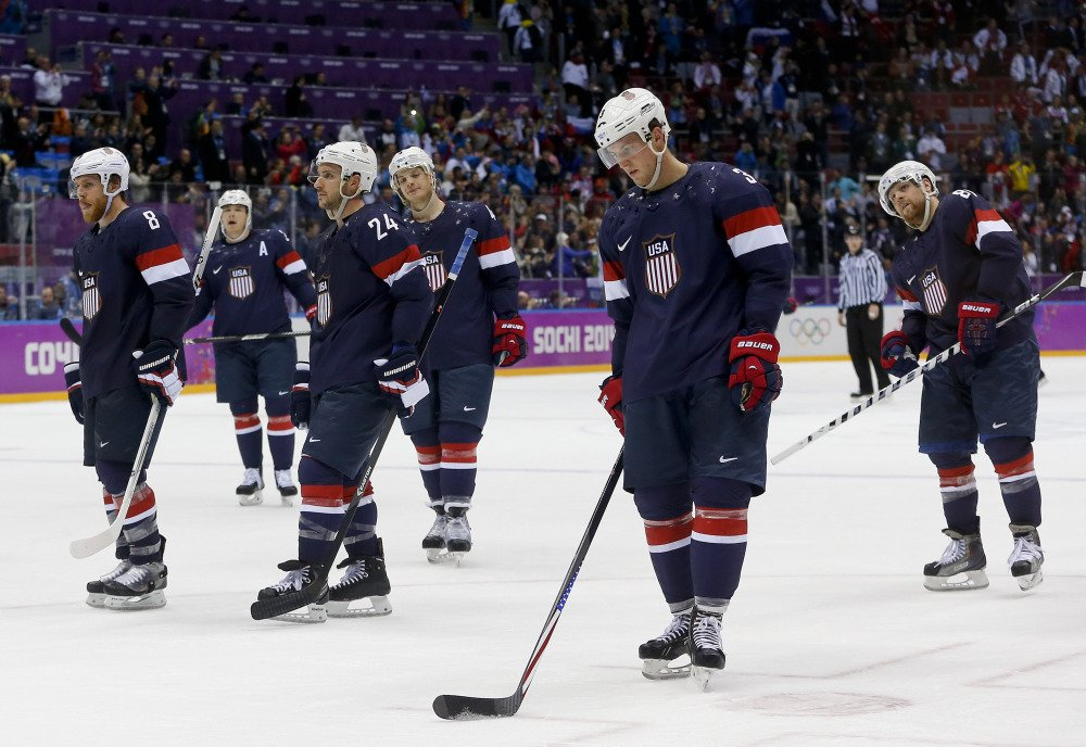 Team USA skates off the ice after losing 5-0 to Finland in the men's bronze medal hockey game Saturday at the 2014 Winter Olympics in Sochi, Russia.