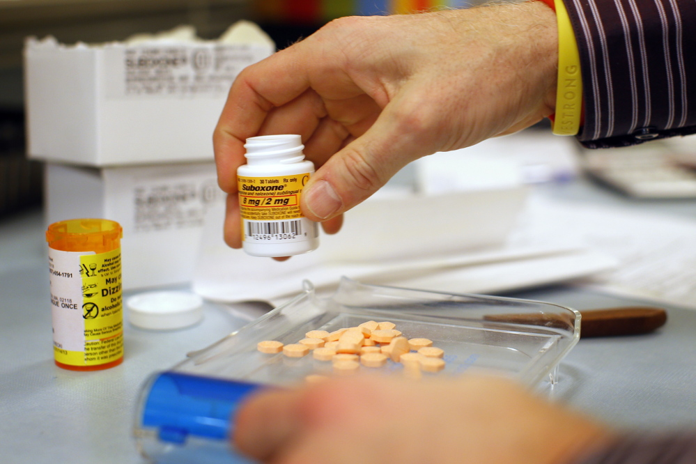 Pharmacist Jim Pearce fills a suboxone prescription at Boston Healthcare for the Homeless Program in Boston last year. Suboxone is an opiate replacement therapy drug used to help treat opiate cravings and withdrawal. Drug treatment officials say addicts often have their doses of suboxone or methadone tapered gradually until they no longer need it, but that timeline can vary depending on the severity of one's addiction.