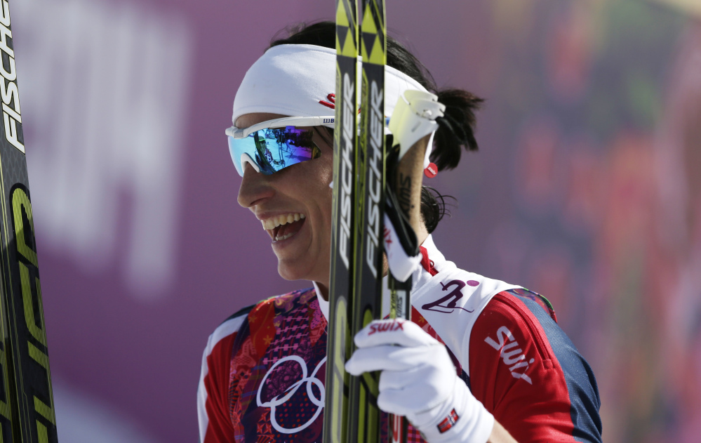 Norway's Marit Bjoergen smiles after winning the gold during the women's 30K cross-country race at the 2014 Winter Olympics Saturday.