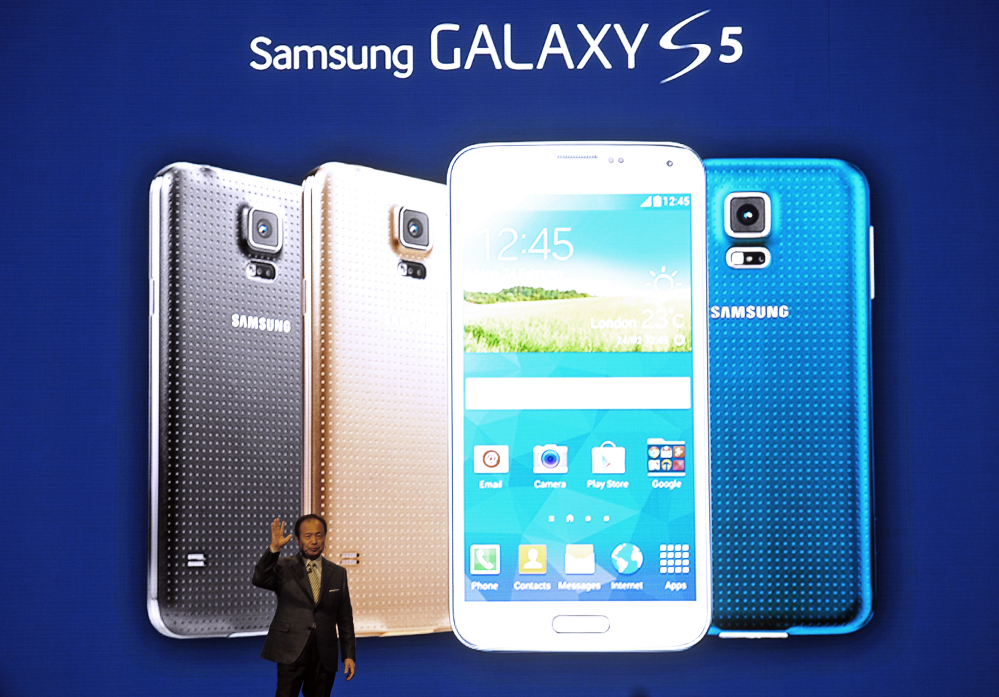 Samsung CEO J.K. Shin presents the new Samsung Galaxy S5 at the Mobile World Congress, the world's largest mobile phone trade show, in Barcelona, Spain, on Monday.