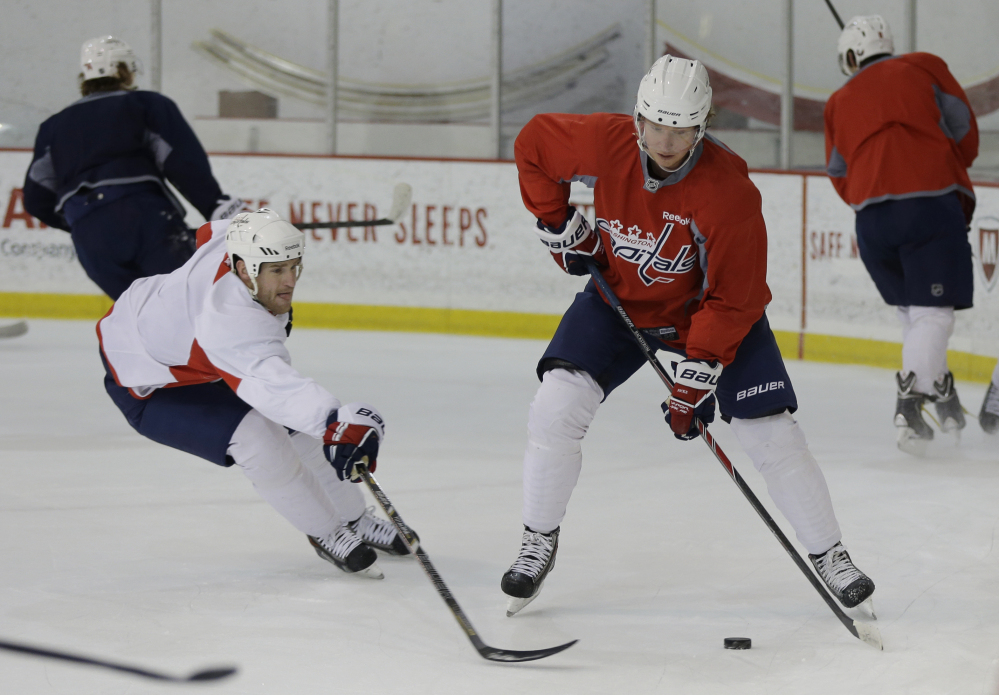 BACK TO WORK: Washington Capitals center Nicklas Backstrom, right, works out Tuesday during practice in Arlington, Va. The league is back and running after a three-week break due to the Winter Olympics.