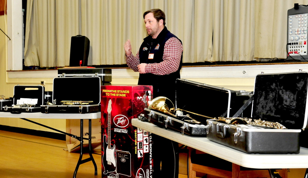 THE BEAT GOES ON: Jim Neville, of the Cole Land Transportation Museum, speaks with Quimby Middle School students Tuesday while donating music instruments to their school.