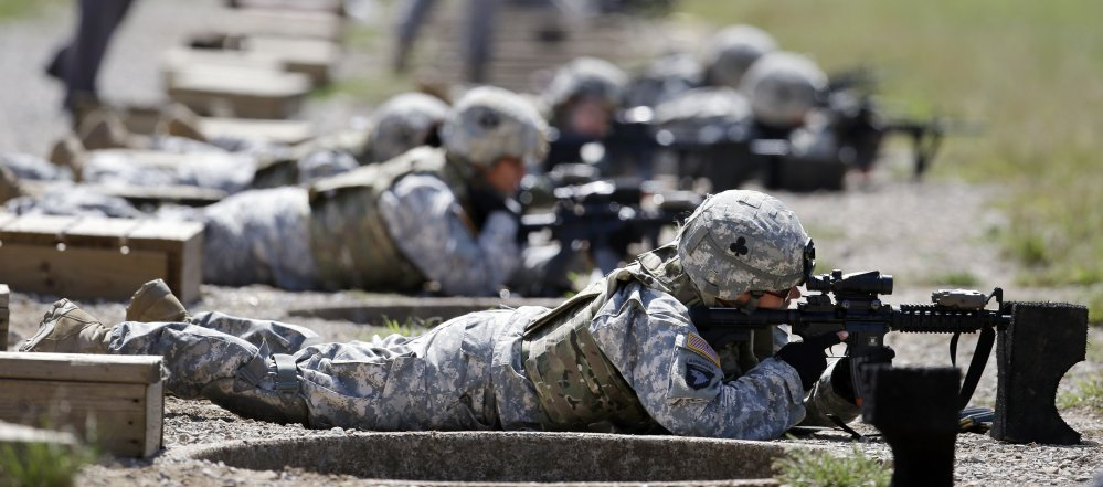 Female soldiers train on a firing range while wearing new body armor in Fort Campbell, Ky., in this 2012 photo.