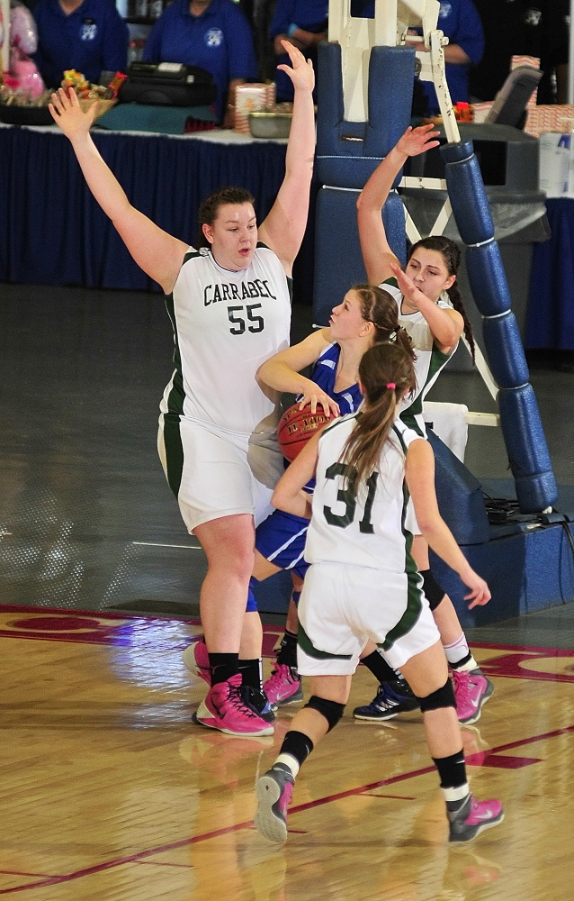 Staff photo by Joe Phelan Carrabec defenders Emma Pluntke, left, (55), Jerzee Rugh (31) and Mickayla Willette swarm Madison's Kirsten Wood during the Class C West girls championship game on Saturday February 22, 2014 at Augusta Civic Center.