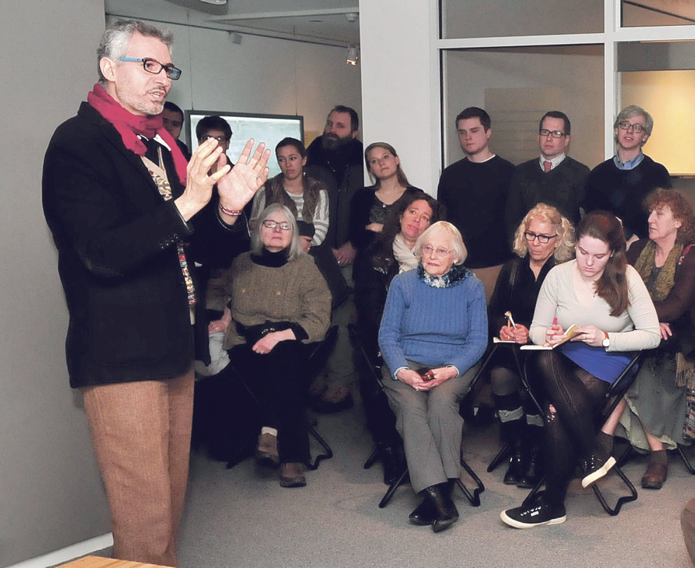 """HISTORIC: Ahmed Abdalla, artist and co-curator of the exhibit """"Histories of Now: Six Artists of Cairo,"""" led people through the exhibition at the Colby College Museum of Art in Waterville on Thursday."""