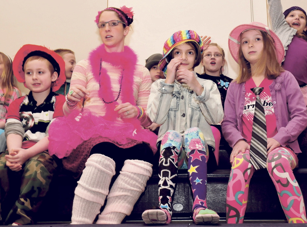 """INTERACTIVE: Students and teachers got dressed up for a presentation on Thursday by Skowhegan native and author Lynn Plourde at Madison Elementary School. Plourde read from her new book, titled """"You're Wearing THAT To School?"""" From left are Nick Krajewski, teacher Katie Flannery, Laura Holden and Gabby Sawyer."""