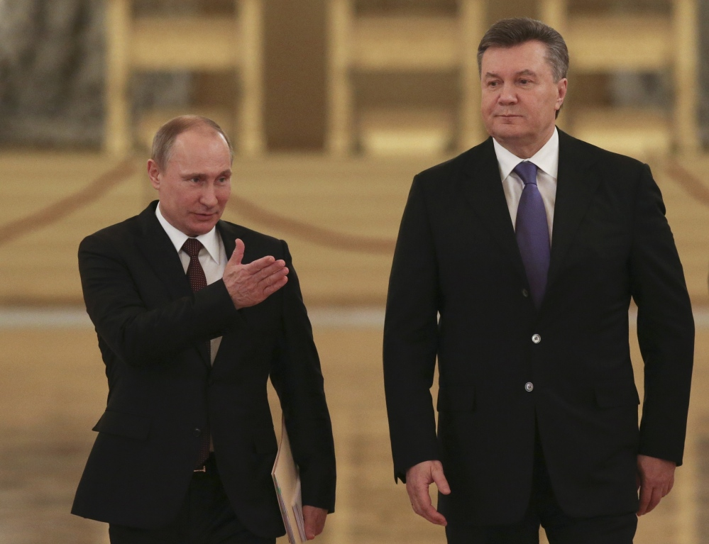 Russian President Vladimir Putin, left, appears with his Ukrainian counterpart Viktor Yanukovych during a Dec. 17, 2013, meeting in the Kremlin.