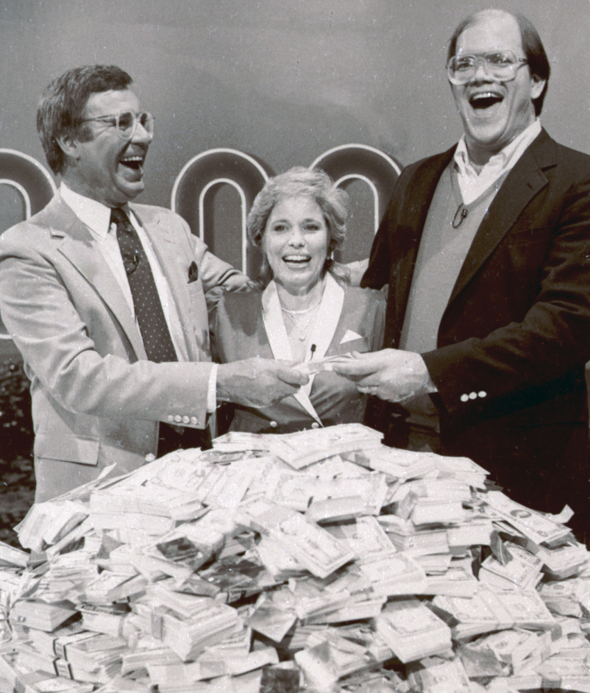 "This 1986 photo shows host Jim Lange, left, congratulating Connie and Steve Rutenbar of Mission Viejo, Calif., after they won $1 million on the TV show ""The $1,000,000 Chance of a Lifetime."""