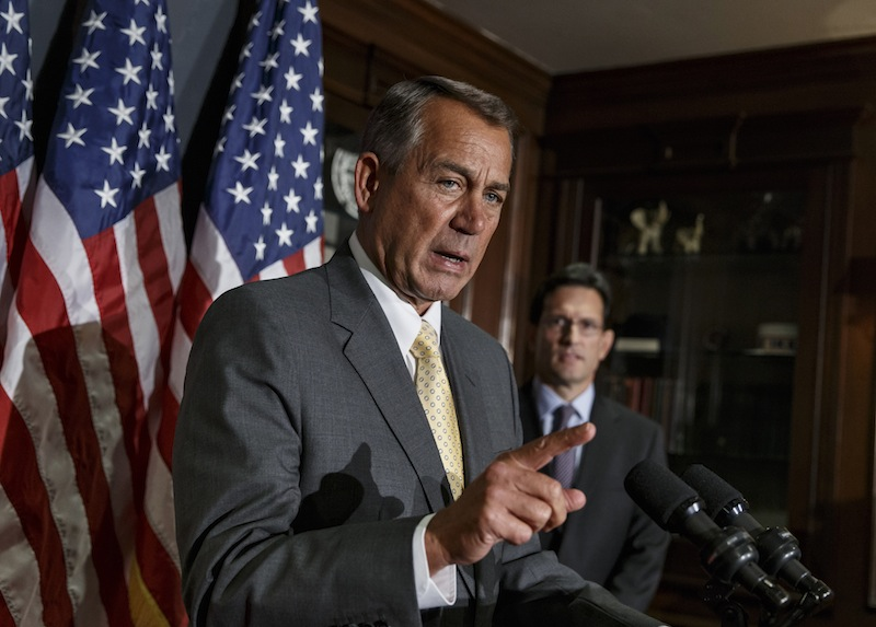 Speaker of the House John Boehner, R-Ohio, and House Majority Leader Eric Cantor, R-Va., at right, talk with reporters in January after a GOP strategy session. House Republican leaders are struggling to devise a way forward on must-do legislation to increase the government's borrowing cap.