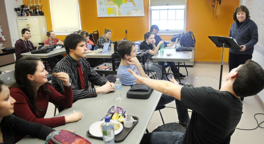 Staff file photo by Joe Phelan CONDITIONING: Teacher Cathy Foyt challenges members of Monmouth Academy's Academic Decathon team last month. The team placed second behind Scarborough High School in the all-day decathlon last Saturday.