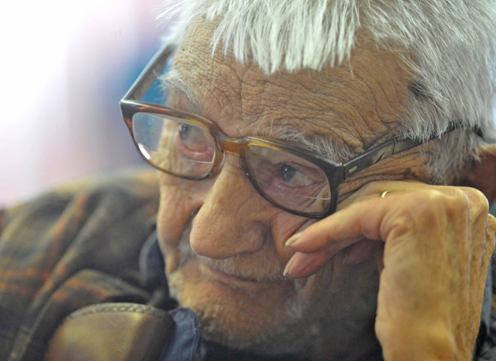 Life Attendant: Laurence Amazeen, 99, listens to the town meeting budget during the annual Town Meeting at the Cornville Town Hall on Saturday. Amazeen also turned 99 on Saturday making him the oldest vote in the meeting. He has been attending since he was 14 years old.