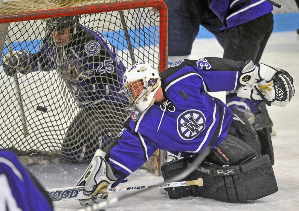 HIGH SCHOOL HOCKEY: Waterville Senior High School goalie Kaleb Kane, 33, tries to make a save against Presque Isle High School at Sukee Arena in Winslow on Saturday. Presque Isle defeated Waterville 5-4.
