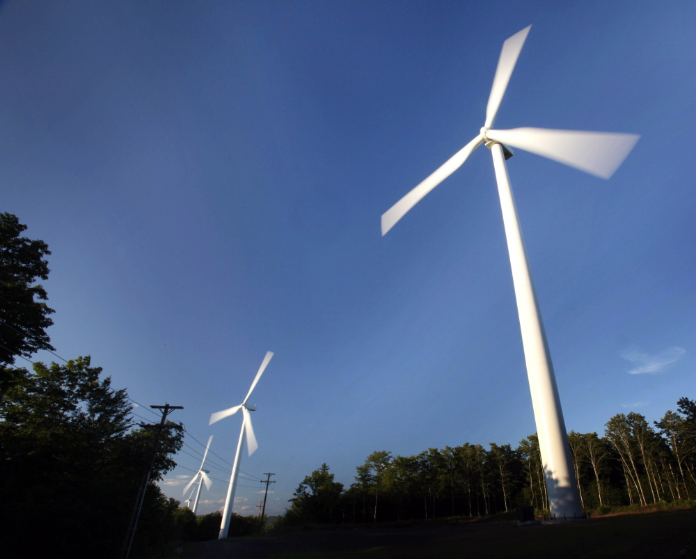 Windmills catch the breeze on Stetson Mountain, in Range 8, Township 3. Gov. Paul LePage proposes eliminating the wind energy generation goals in Maine law.