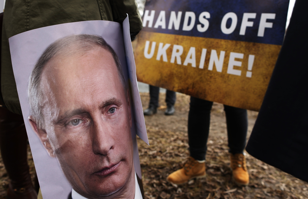 Demonstrators gather outside the Russian Embassy in Vilnius, Lithuania, to protest against Russian intervention in Ukraine.