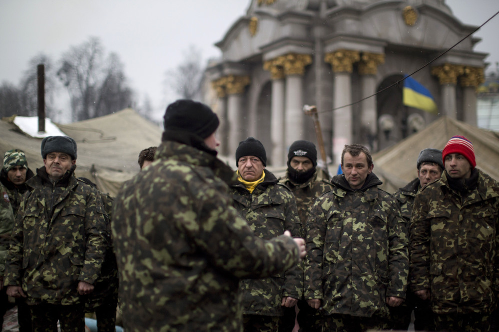 Ukrainian recruits receive instructions from a commander in a recruitment self defense quarter at Kiev's Independence Square on Monday. The U.S. and its allies are weighing sanctions on Moscow and whether to bolster defenses in Europe in response to Russia's military advances on Ukraine.