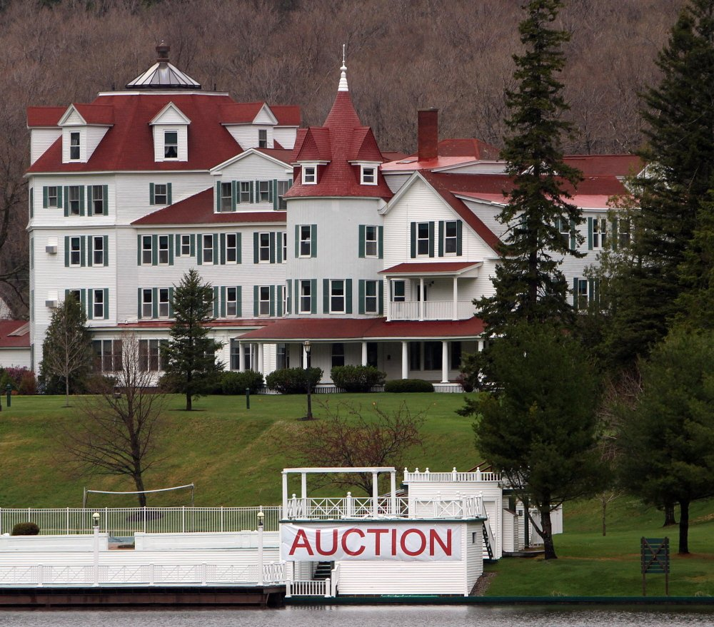 A large sign is seen in front of the Balsams Hotel in Dixeville Notch, N.H., prior to an auction to clear it out after it was sold to two businessmen for $2.3 million. They have since entered into an agreement with Les Otten to redevelop the property.