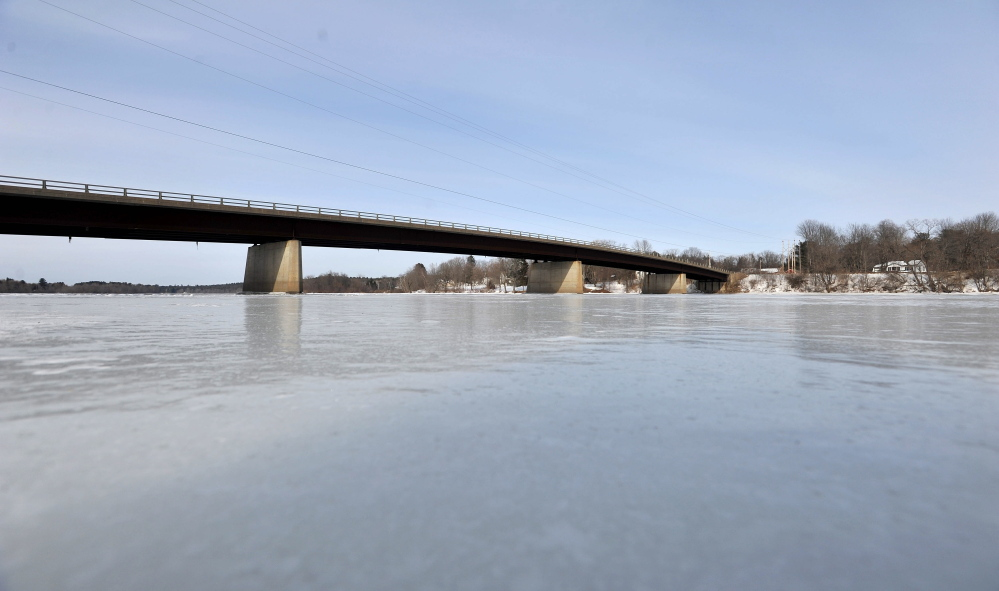 ICY RIVER: The Canaan Road bridge spans the frozen Kennebec River in Fairfield on Tuesday. Officials are keeping an eye on the rivers and hope to find out more soon about the likelihood of spring floods after this winter's heavy snow and cold temperatures.