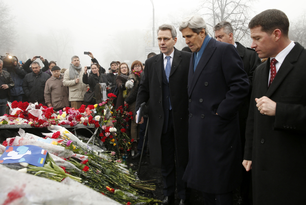 Secretary of State John Kerry visits the Shrine of the Fallen in Kiev on Tuesday. The shrine honors the nearly 100 protesters who have been killed by police over the past several weeks.