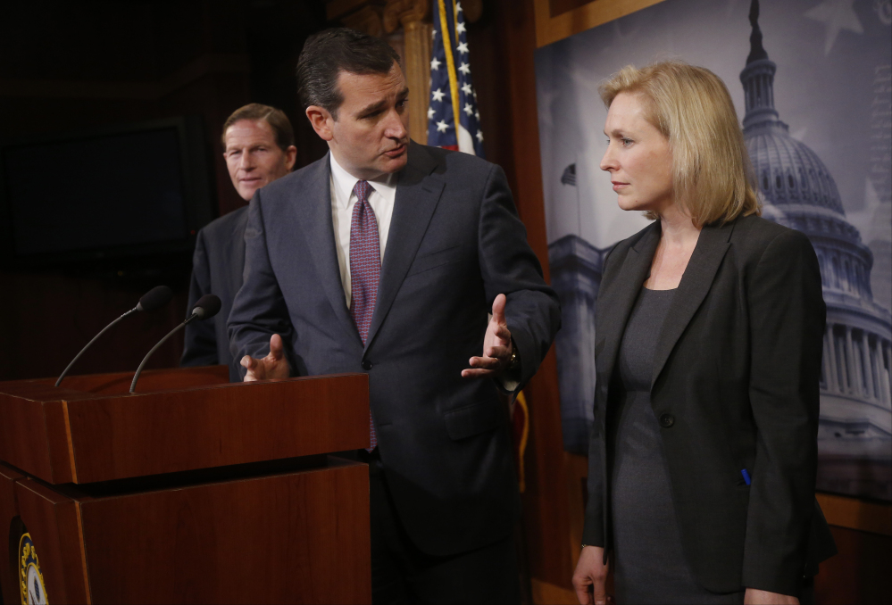 Sen. Ted Cruz, R-Texas, center, talks with Sen. Kirsten Gillibrand, D-N.Y., on Capitol Hill in Washington on Thursday during a news conference following a Senate vote on military sexual assaults.Cruz supported Gillibrand's bill.