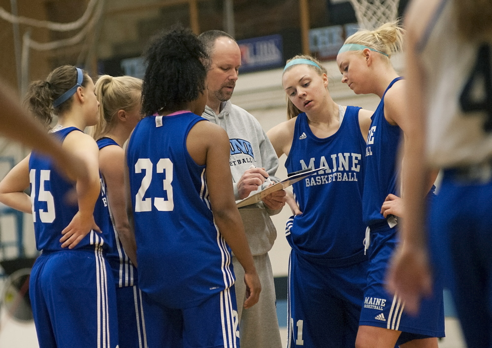 Surrounded by his players at a practice this week, University of Maine women's basketball coach Richard Barron goes over a play at the Memorial Gym in Orono. After an impressive regular season, the team plays Hartford tonight in the quarterfinals of the America East Conference tournament.