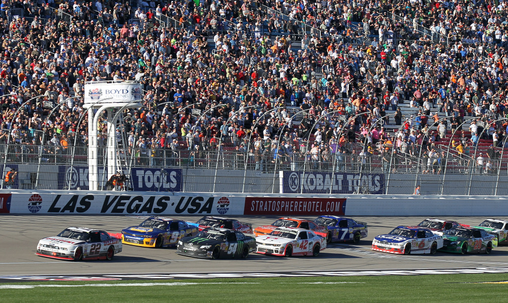 Brad Keselowski (22) leads as drivers take the green flag following a caution period during the NASCAR Nationwide Series auto race Saturday in Las Vegas.