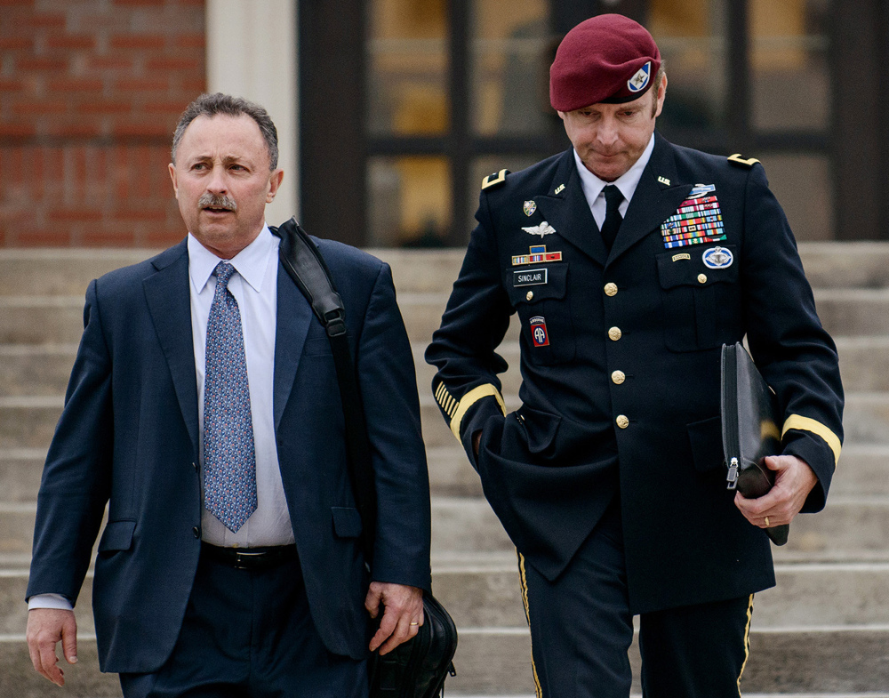 Brig. Gen. Jeffrey Sinclair, right, leaves the courthouse with his lawyer Richard Scheff last week in Fort Bragg, N.C. A military judge declined Monday to dismiss sexual assault charges against Sinclair after reviewing what he said was evidence that political considerations influenced the military's handling of the case.