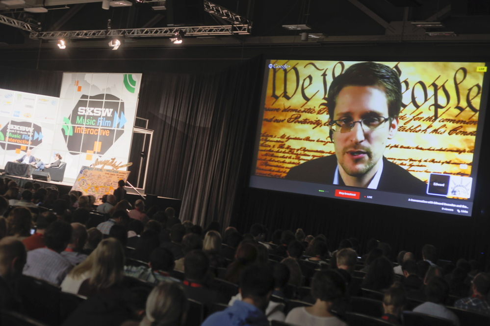 Edward Snowden talks during a simulcast conversation during the SXSW Interactive Festival on Monday in Austin, Texas. Snowden talked with American Civil Liberties Union's principal technologist Christopher Soghoian, and answered tweeted questions.