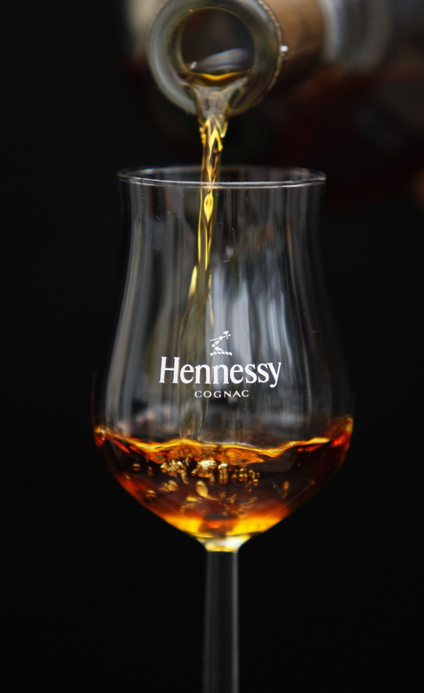 """Rappers like P. Diddy and Nas have contributed to the popularity of cognac, such as Hennessy, among young black drinkers nationally. A proposed ban on the products at a Portland nightspot as a means of limiting """"detrimental conduct"""" has raised questions about possible profiling."""