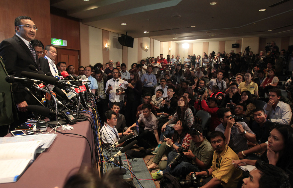 Malaysian acting Transport Minister Hishammuddin Hussein, left, answers a question during a news conference at a hotel in Sepang, Malaysia, on Wednesday.