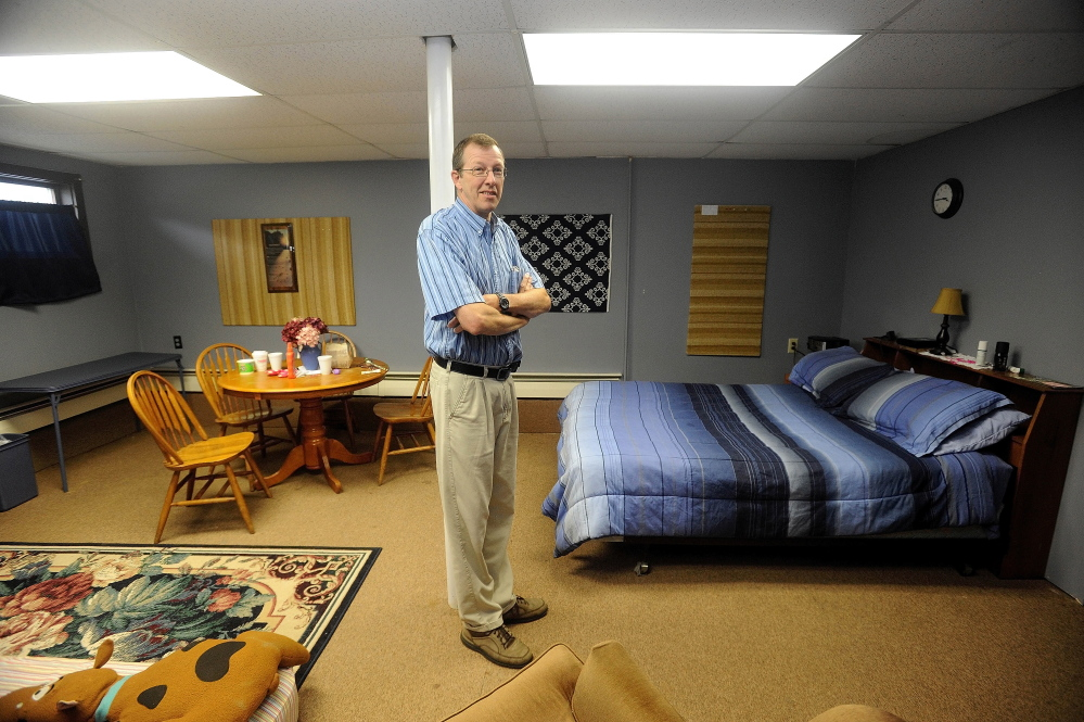 SHELTER: Steve Bracy, pastor of Living Waters Assembly of God Church and vice president of Western Maine Homeless Outreach, stands in the only private room at the church. The basement of the 547 Wilton Road church in Farmington has been renovated to help handle the needs of homeless families.