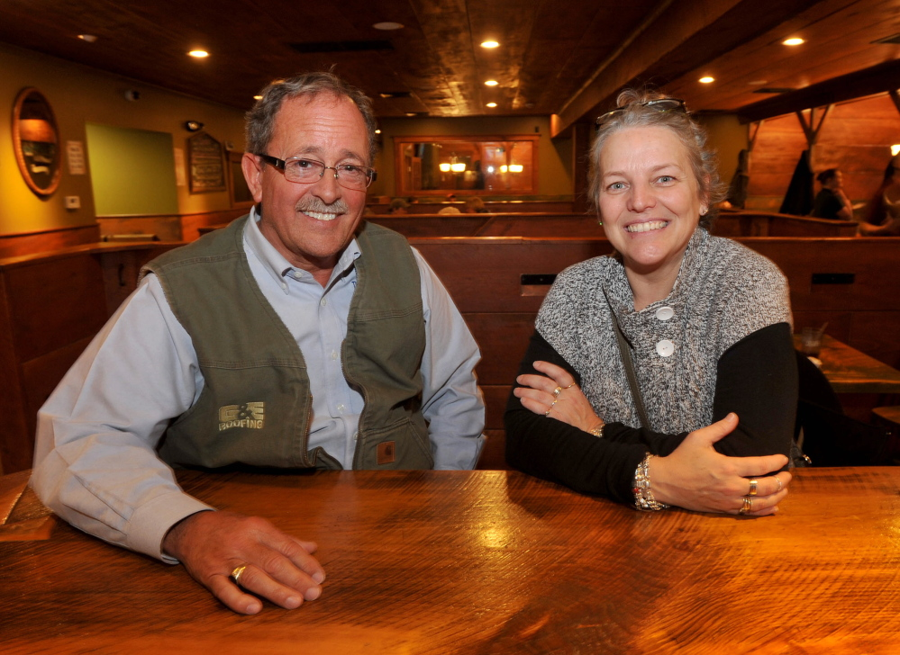 CURRENT AND FUTURE OWN-AHS: Norm Elvin, left, current owner of the China-Dineah, and future owner Lisa Wardwell at the China Dine-ah in South China on Friday, March 14, 2014.
