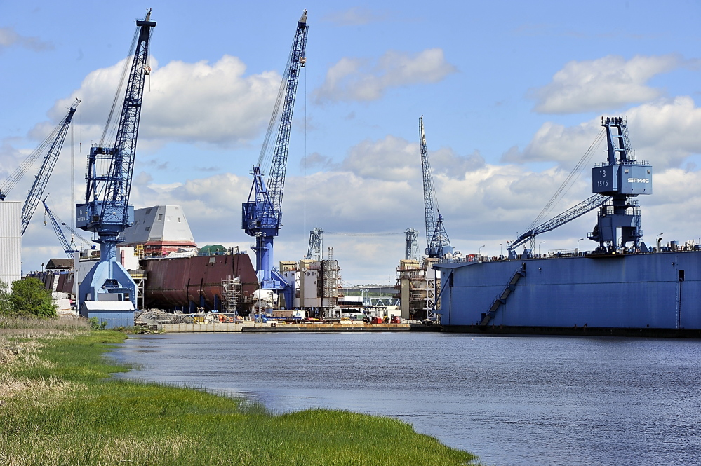 The Bath Iron Works complex of cranes, manufacturing buildings and, at right, a dry dock, is seen on the Kennebec River in this June 2013 file photo.