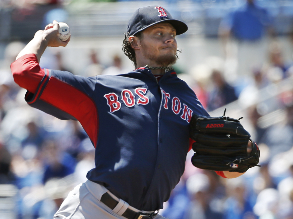 Boston's Clay Buchholz is in command Friday afternoon in Dunedin, Fla., blanking the Toronto Blue Jays in his four innings on the mound. Buchholz was 12-1 last season before being sidelined with injuries.