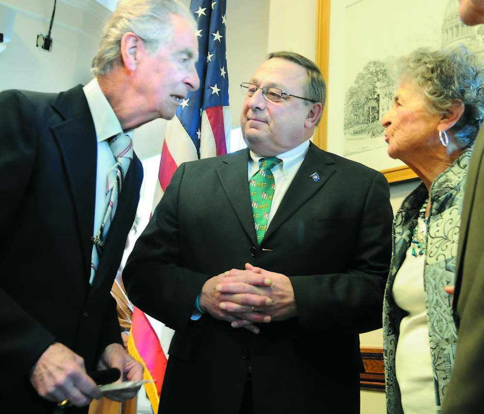 "HALL OF FAMER: In this 2012 file photo, Augusta resident Leo Pepin, left, and his sister, Madeline Patenaude, speak with Gov. Paul LePage after LePage signed a bill to designate the ""Dirigo March"" as the official state march. Next week, Pepin will be inducted into the Franco-American Hall of Fame."