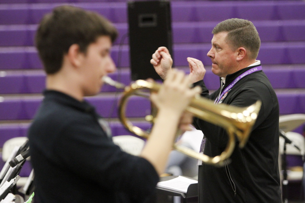 South Portland High School jazz band director Craig Skeffington conducts the group as Alex Quinn performs a solo on the flugelhorn.