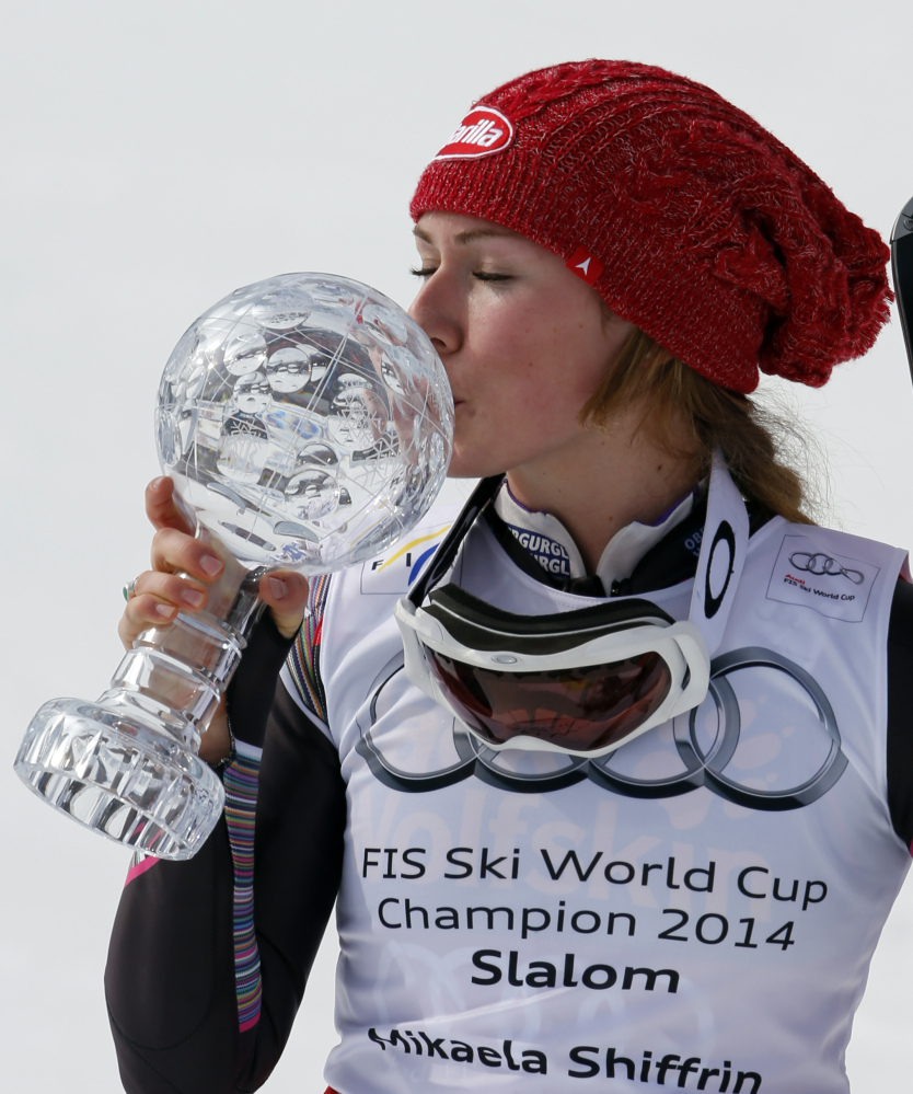 Mikaela Shiffrin of the United States kisses her trophy after winning an Alpine Ski women's slalom at the World Cup finals, in Lenzerheide, Switzerland, on Saturday.