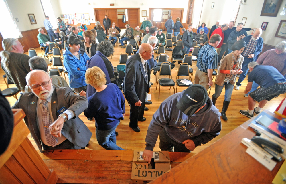 Thinking inside the box: Residents of Benton cast their ballots during a vote on whether to establish a tax increment financing district Saturday during the Town Meeting at the Benton Grange.