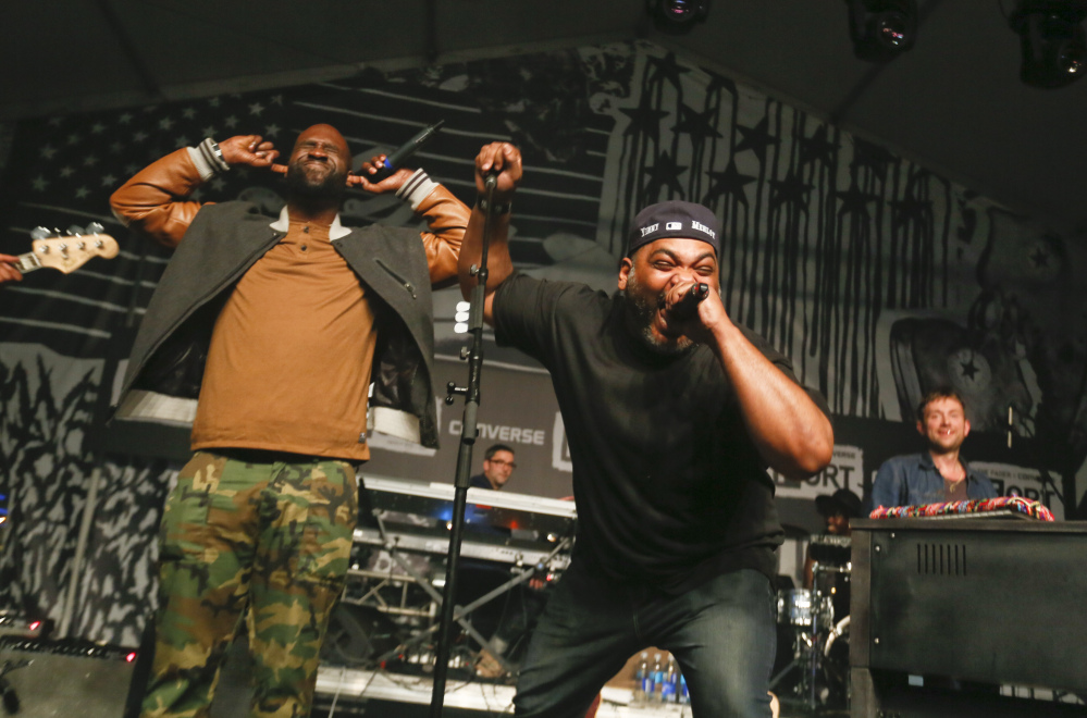 De La Soul's Kevin Mercer and Vincent Mason, from left, join Damon Albarn, right during the SXSW Music Festival Friday in Austin, Texas.