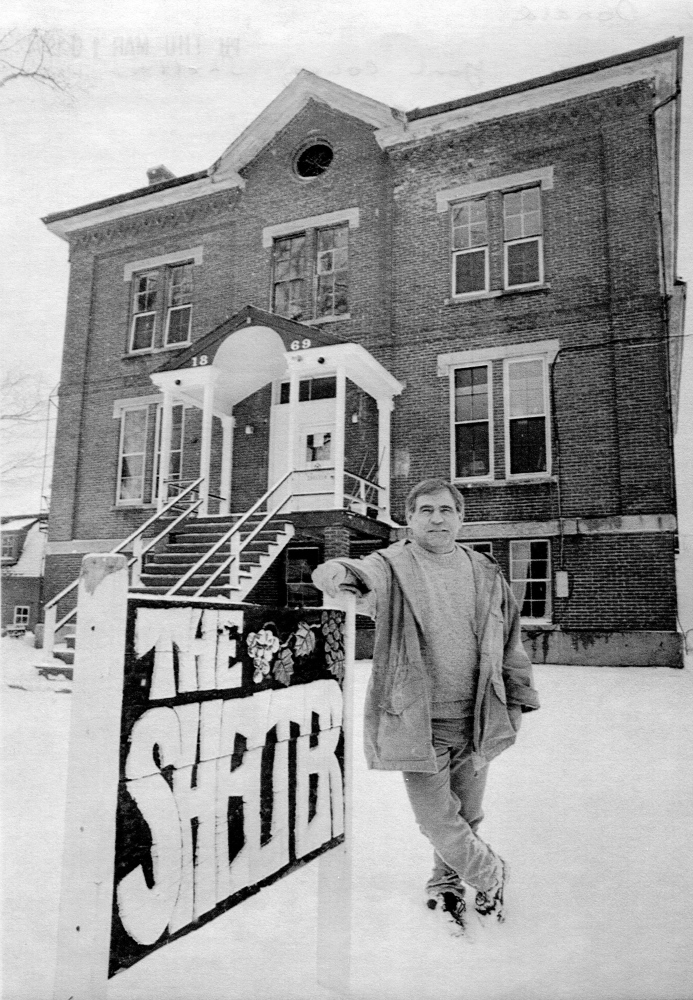 Don Gean stands in front of the original homeless shelter in Alfred for this photo in 1994. The shelter was housed in the former jail before being moved into a more comfortable building that year.